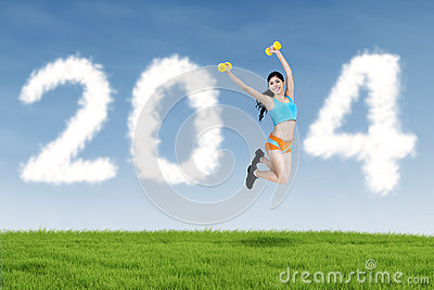 new-year-clouds-fitness-woman-jumping-happy-outdoor-33821399[1]